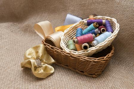 kanzashi: Handicraft supplies in basket on burlap background