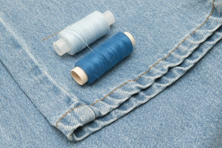 darning needle: Sewing supplies and old clothes for repair. Photo