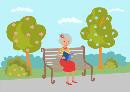 Elderly woman sitting on the park reading book