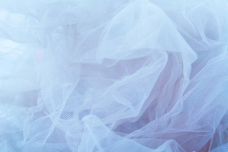Lightweight fabric mesh lace, texture of the fabric is beautifully draped background Stock Photo