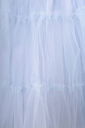Blue fabric texture background. The skirt is made of tulle Zdjęcie Seryjne - 126892823