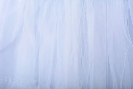 Blue fabric texture background. The skirt is made of tulle