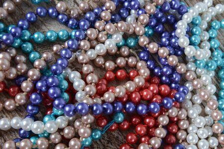 Background of colorful beads on the table. Christmas decoration