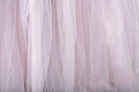 Pink fabric texture background. The skirt is made of tulle Zdjęcie Seryjne - 126893131