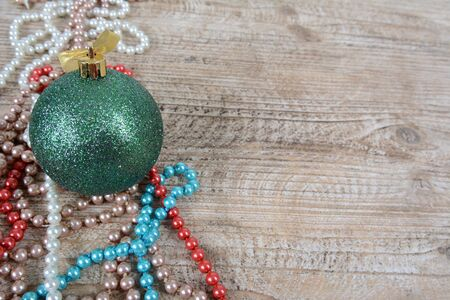 Christmas decorations beads and balls on table Zdjęcie Seryjne