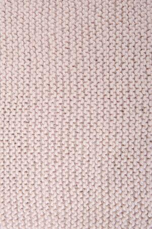 Biege knitted texture fragment. Handmade women hobby