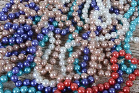 Background of colorful beads on the table. Christmas decoration Zdjęcie Seryjne - 126893364