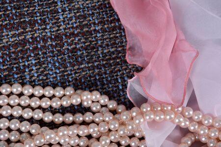 Pearl necklace on a gray fabric background Zdjęcie Seryjne
