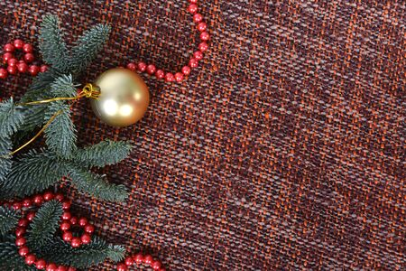 Christmas ball and red pearl necklace on the branches fir tree