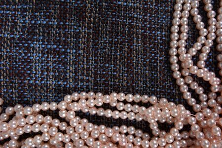 Pearl necklace on the gray background texture