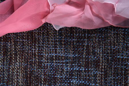 Gently pink silk fabric on the gray background