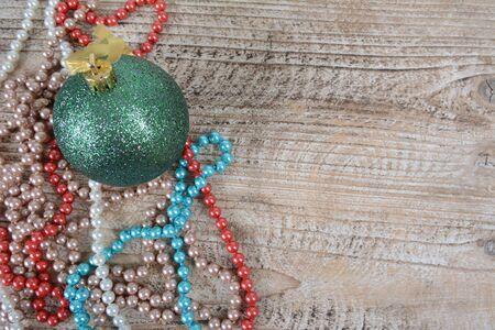 Christmas decorations beads and balls on the table Фото со стока