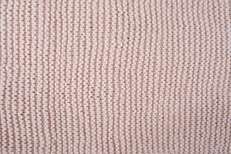 Beige knitted textured fragment knitted Фото со стока