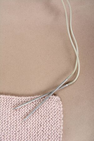 Wool thread and beige knitted scarf.