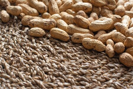 Peanuts on a wicker surface
