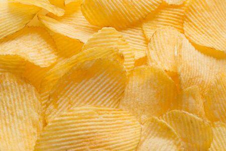 Potato chips background. Close-up photo Zdjęcie Seryjne
