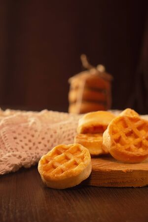 Waffle round-shaped biscuits on the table, white plate
