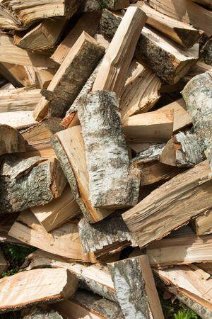 Birch firewood. A pile of split logs.