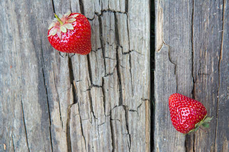 Strawberries on the surface old wooden table
