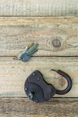 Opened old rusty lock with keys. Copy space. Looking for problem solution concept