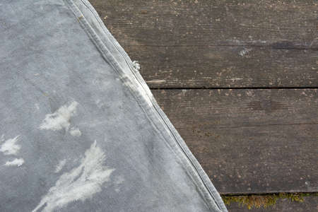 Old rough burlap on the surface of vintage table. Wooden rag two texture rustic style.