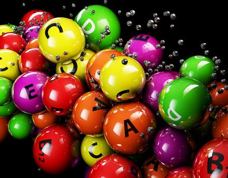 vitamine: 3d multicolor ball Vitamine on a black background Stock Photo