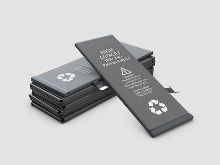 Batteries de téléphones portables rechargeables. Isolé sur fond gris