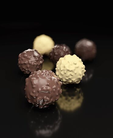 Dark chocolate balls isolated on black background 3d rendering 写真素材