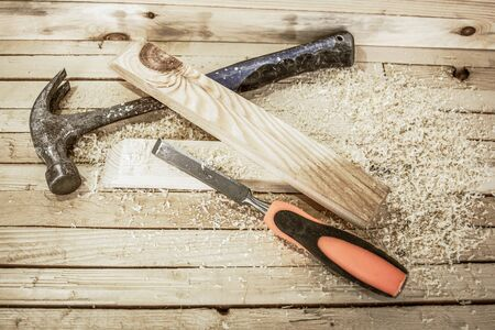 Woodwork tools on the boards background