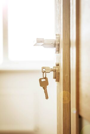 Door lock , door open in front of room blur background
