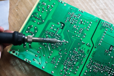 Technician repairing  a television  photo
