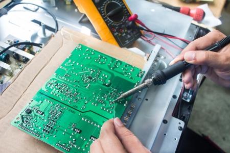 Technician repairing  a television