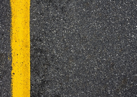 yellow line on the road texture background photo