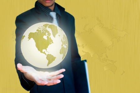 gold world in hand business background  photo