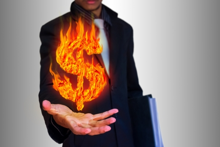 businessman and abstract fire dollar symbol  Stock Photo