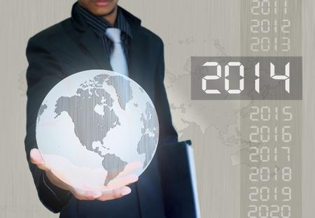 silver ball earth in hand businessman 2014  year Standard-Bild