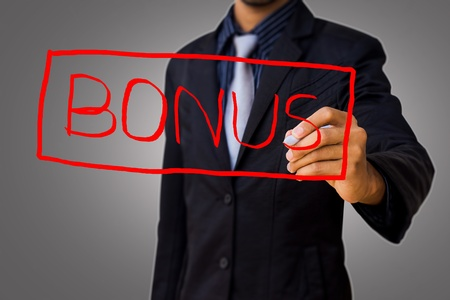 Writing bonus by businessman  Stock Photo