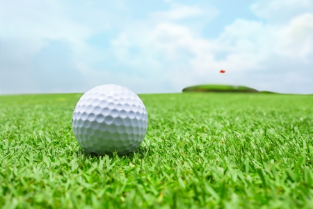 Golf ball on grass away from the hole  photo