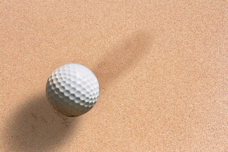 golf ball on sand background  photo