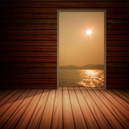 Wooden doors open to the sea  photo