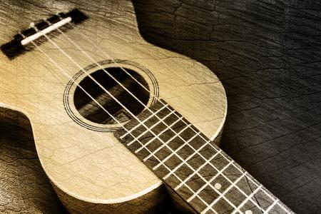 country music: Ukulele in wood texture background  Stock Photo