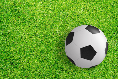 soccer ball on green grass texture background photo