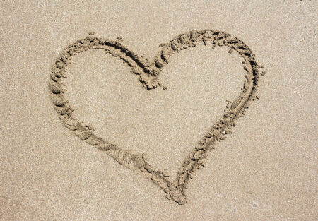 Heart on sand beach photo