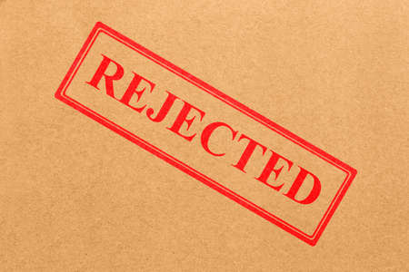 rejected: rejected stamp on cardboard texture