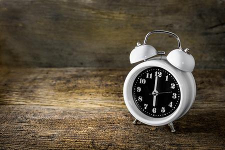 alarm clock on old wood background Stock Photo