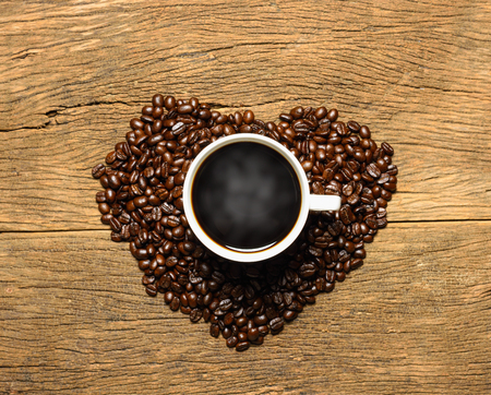 Coffee cup on heart from coffee beans