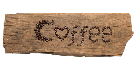Coffee symbol made from coffee beans on wooden