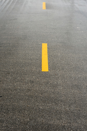 Yellow lines on the asphalt road