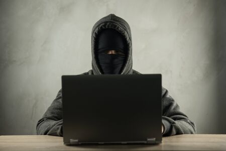 Hacker using laptop. Hacking the Internet server. Reklamní fotografie
