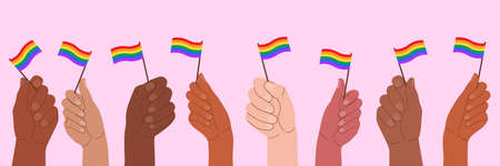 People at the pride parade hold flags and posters with the LGBT symbol. The right to self-affirmation and equality. Celebrating Pride Month against discrimination and violence.